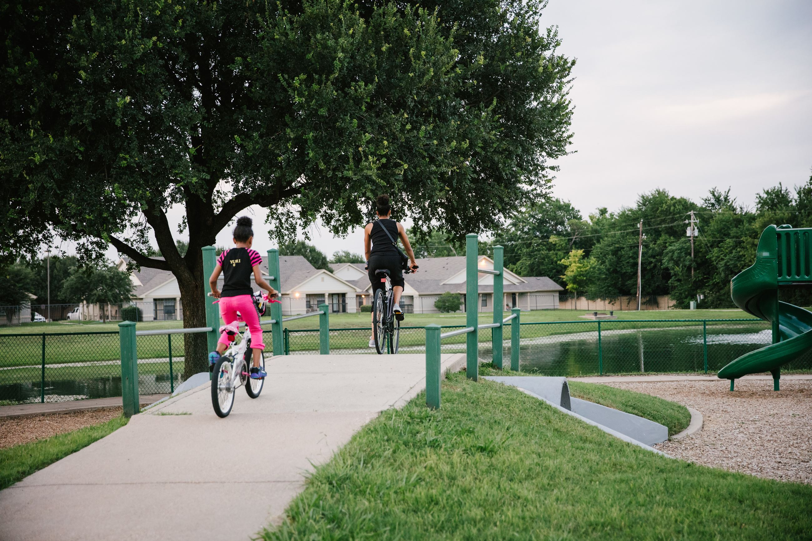 Mother and daughter riding bikes on trail at Windsor Park