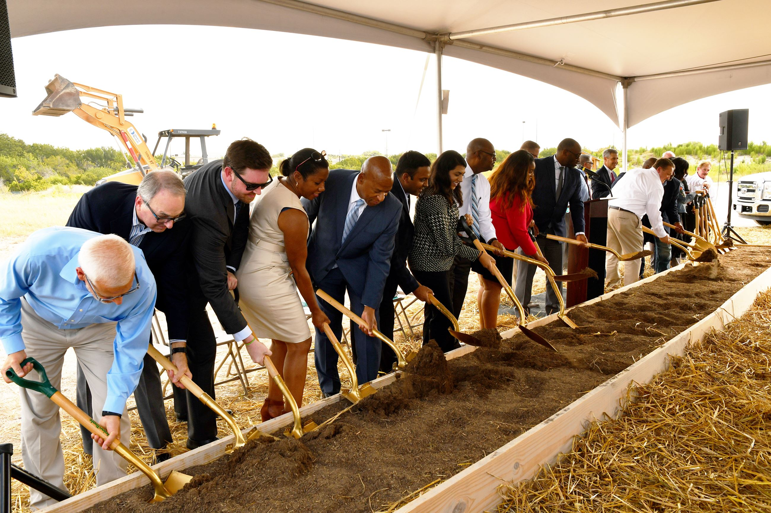 City Council Members and Guests shovel dirt at the Hotel & Convention Center groundbreaking