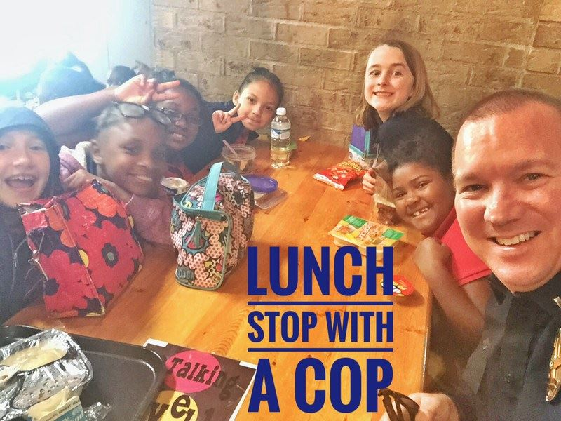 Police Officer having lunch with children for the Lunch Stop with a Cop program.